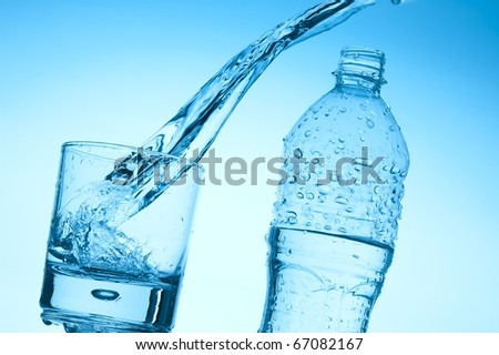 In a glass the fresh stream of water flows - stock photo