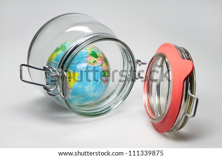 In a Jar is a small globe. - stock photo