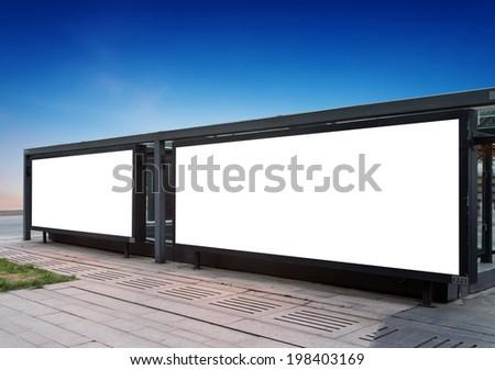 In a large blank roadside billboard - stock photo
