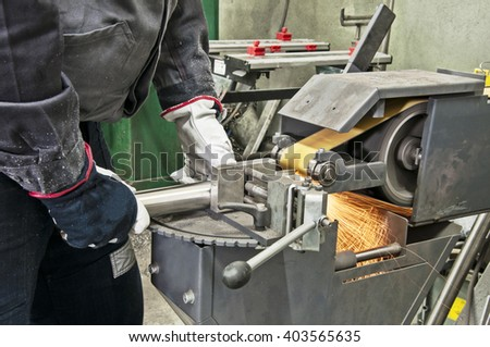 in a metal workshop - grinding