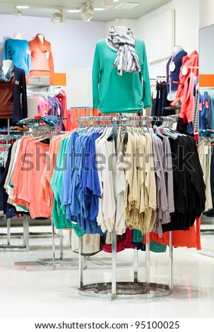 In a modern fashion clothing store - stock photo