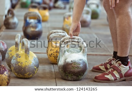 In a sports hall set of weights - stock photo