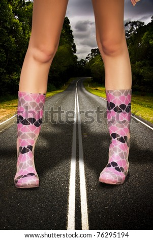 In A Storm Rain And Weather Concept A Giant Stands In Large Gum Boots On A Road Or Highway In A Colossal Overgrown And Gigantic Image Representing The Big Wet - stock photo