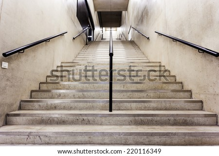 in an big building is there an long staircase - stock photo