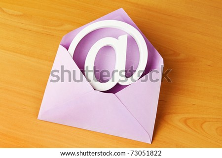 In an envelope is sign an e-mail. Mail to electronic mail. - stock photo
