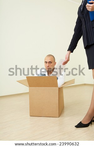 In an interior the woman shows to the debtor the warrant - stock photo