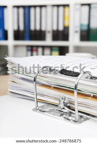 in an office at a desk is a file folder - stock photo