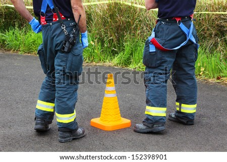 In any urban area the fire departments and emergency response teams will conduct disaster preparedness drills. These two fire department team members are at the injury assessment gathering point. - stock photo