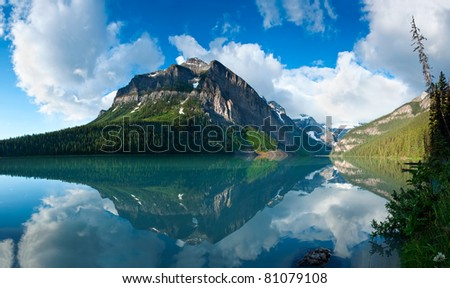 In Banff National Park, Alberta, Canada, a beautiful reflection of the mountain peaks around Lake Louise