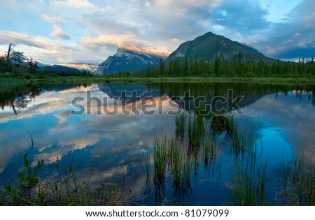 In Banff National Park, Alberta, Canada, a beautiful sunset reflection of Mt. Rundle in the Vermillion Lakes.