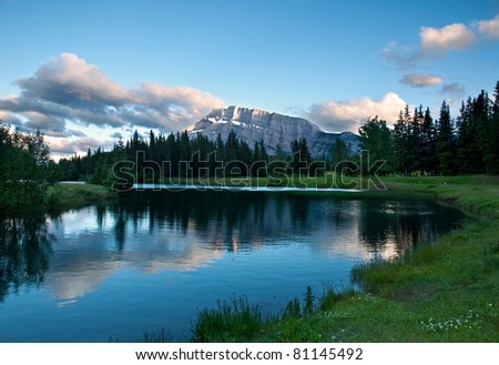 In Banff National Park, Alberta, Canada, Cascade Pond with Mt. Rundle the peak in the distance. - stock photo