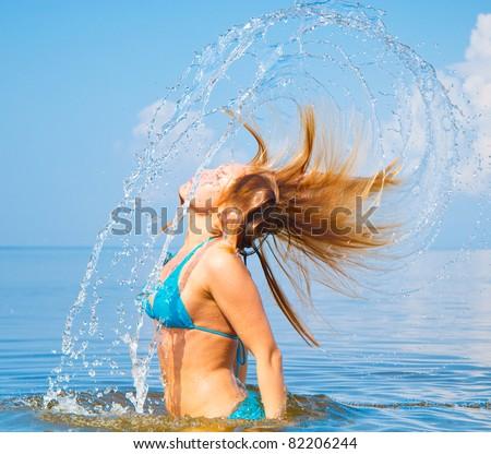 In Bikini Playing On a Beach - stock photo