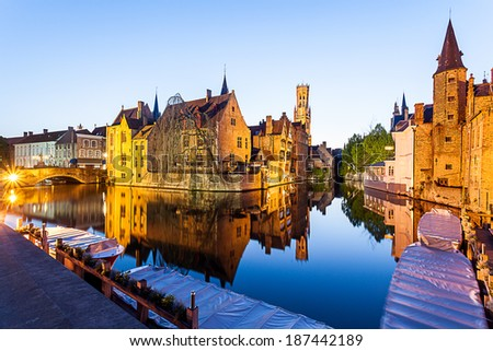 In Brugges at sunset during the blue hour, you see the refection of the building and the tower - stock photo