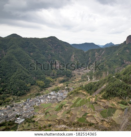 """In China, Wenzhou, """"Yandang Mountain"""", at the foot of the mountain villages and islands. (Yandang Mountain is China's famous geological park, formed in 120 million years ago) - stock photo"""