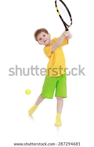 In dynamics a little boy has a tennis racket-Isolated on white background - stock photo