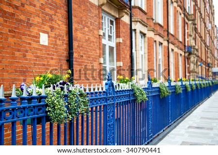 in europe london old red brick wall and              historical window - stock photo