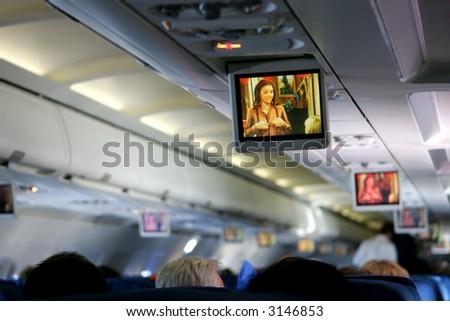 In-flight entertainment on airplane - stock photo
