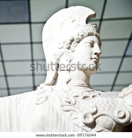 In Greek mythology, Athena is the goddess of wisdom, courage, inspiration, strength, strategy, female arts, crafts, justice, and skill. - stock photo