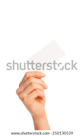 in hand a blank sheet of white paper held diagonally. Isolated, over white background. - stock photo