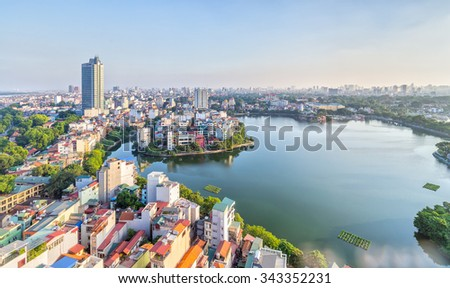 In Hanoi, Vietnam, 28th September, 2015: Urban development capital Hanoi with large beside lakes skyscraper architecture as a luxury resort perfect for watching sunset at West Lake, Hanoi, Vietnam - stock photo