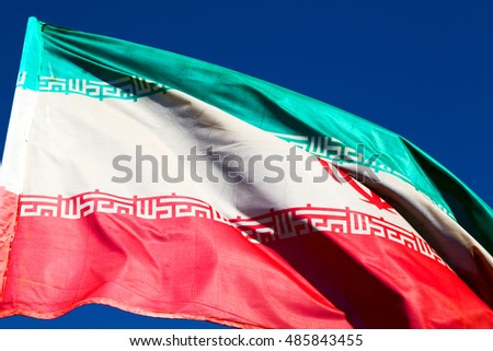 in iran   iranian waving flag  the blue sky and wind