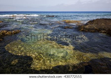 in lanzarote spain  rock stone sky cloud beach  water  musk pond  coastline and summer  - stock photo