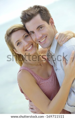 In love couple embracing by the beach - stock photo