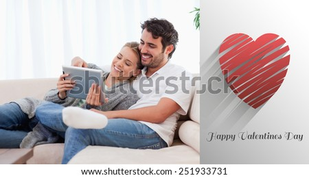 In love couple using a tablet computer against cute valentines message - stock photo