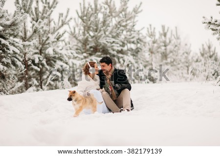 in love with a dog in winter forest