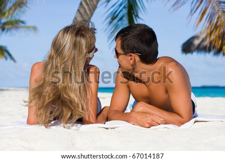 In love young couple on a tropical beach - stock photo