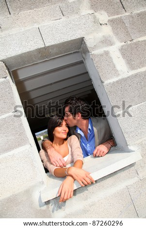In loved couple standing in their future house