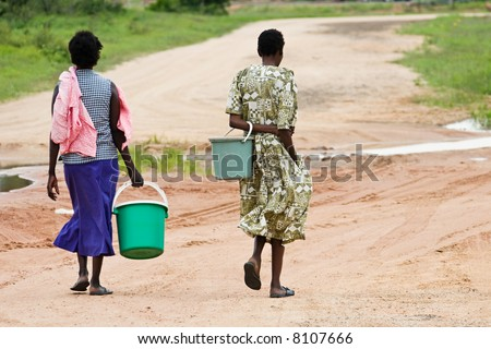 In many African villages, water is a luxury, and everyday people walk few kilometers to get it. - stock photo