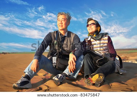 In Oct. 2010, my whole family drove to the largest desert in China. Explore the desert and enjoy the fun. - stock photo