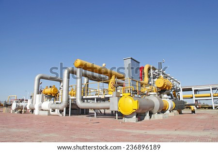 In oil field, there is oil pipeline and oilfield equipment at work - stock photo