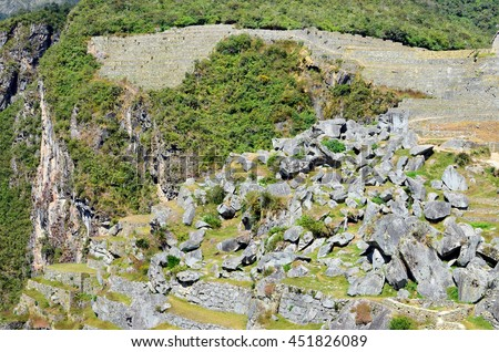 In one photo it is possible to see all history of the Peruvian Andes mountains. Huge granite boulders. Green tropical bushes and trees. Ruins of the ancient stone settlement of the  Inca empire - stock photo