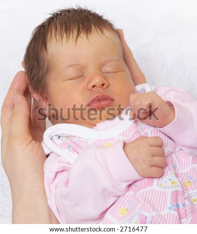 in reliable hands, sleeper baby on the mother`s palm