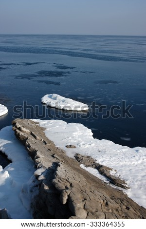 In sea ice, blocks of ice on the sea, winter sea and the ocean, Arctic, aquatic nature, the ice floe in the ocean, melting ice, spring in the North sea, the Arctic in the spring, wildlife. - stock photo