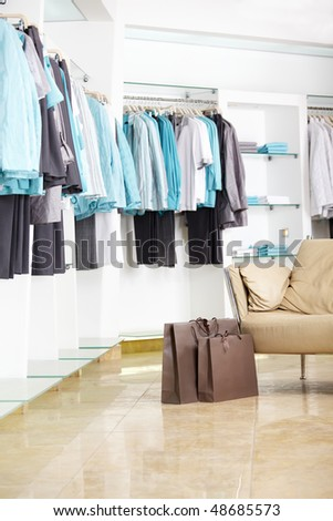 In shop of clothes of a bag with purchases - stock photo