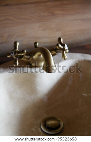 in the bathroom, sink and faucet - stock photo