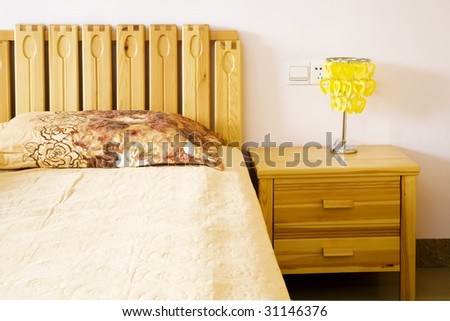 In the bed room,bed and lamp - stock photo