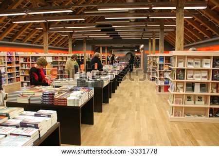 In the book store (shelves of books) - stock photo