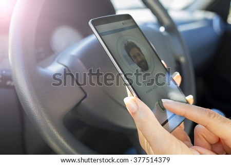 In the car Woman answering mobile phone, calling a friend - stock photo