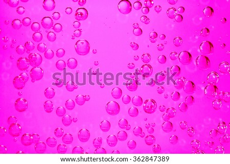 In the carbonated water are many gas bubbles. - stock photo