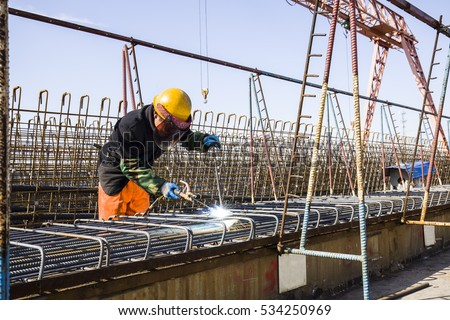 In the construction site, the welding workers at work