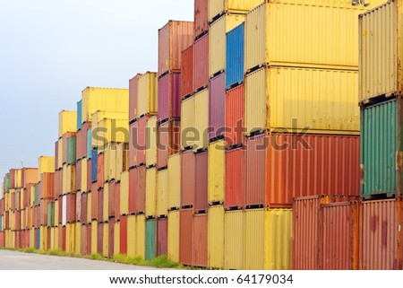 in the container storage area, we can see too much lifting crane and colorful stack under the blue sky _C - stock photo