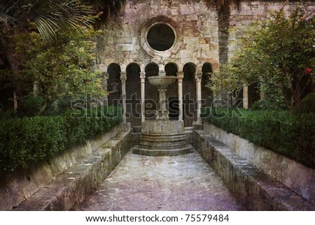 In the courtyard of the medieval monastery of Dubrovnik, Croatia. Postcard from Croatia. More of my images worked together to reflect age and time. - stock photo