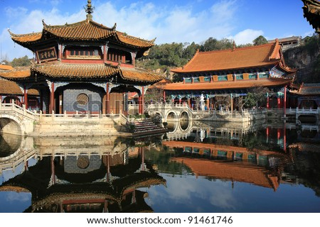 In the courtyard of Yuantong temple in Kunming, China, with the main worship hall in the background. - stock photo