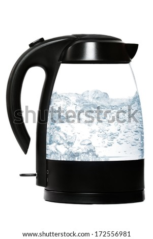 In the electric kettle water boils - stock photo