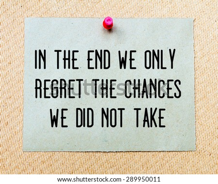 In The End We Only Regret The Chances We Did Not Take written on paper note pinned with red thumbtack on wooden board. Motivation conceptual Image - stock photo