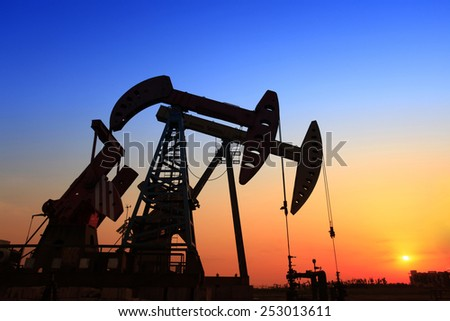 In the evening of the pumping unit outline, it is very beautiful    - stock photo